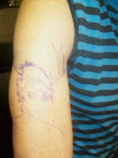 The stencil applied. We planned the placement so the antlers wrap around my baby deltoid arcing down over my shoulder.