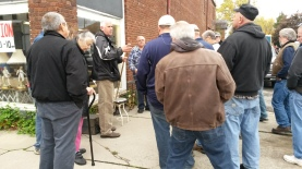 Auction Day - Auctioneer 1 of 3 gets things started outside