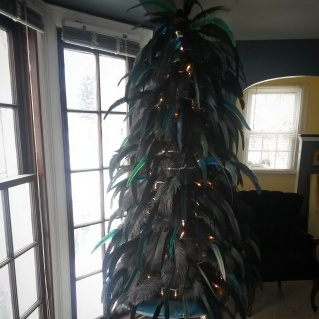 """Another round of feathers in! These are iridescent black & dark green. Now for the bright showstopper feathers that will be the """"ornaments""""."""